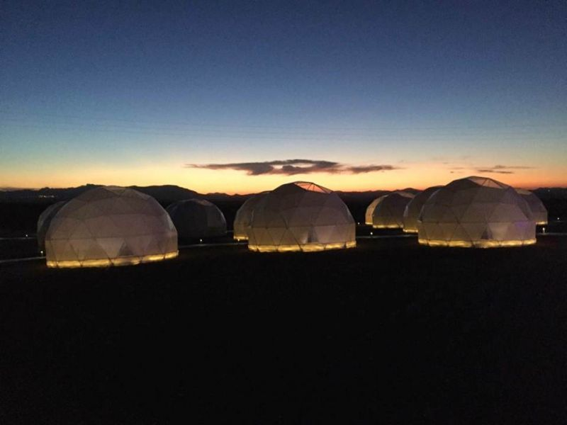 Geodesic dome camp in the evening
